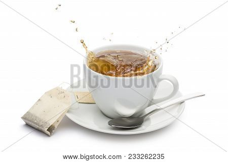 Cup Of Tea With Splashing And Tea Bag On White Background