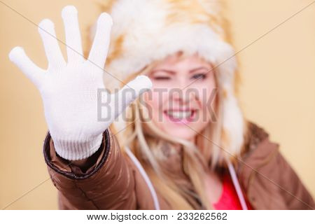 Clothing Accessories, Seasonal Clothes Concept. Woman Wearing Jacket, Winter Furry Warm Hat And Whit