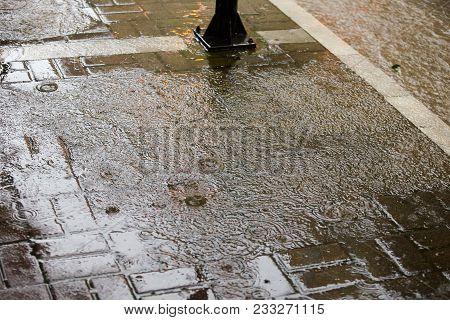 Heavy Rain Drops On Sidewalk While Raining.