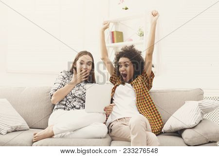 Two Happy Excited Female Friends Using Digital Tablet. Laughing Women Browsing Portable Computer, Ce