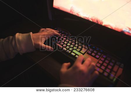 Gamer Hands On The Keyboard While Playing The Computer. Gamer Concept