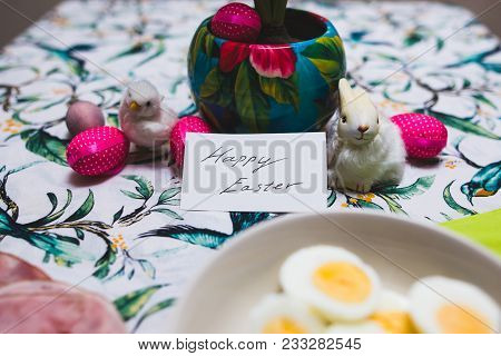 Easter Decorations On Dinner Table With Happy Easter Text.