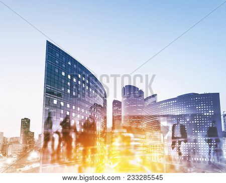 Silhouettes Of People Walking In The Street Near Skyscrapers And Modern Office Buildings In Paris Bu