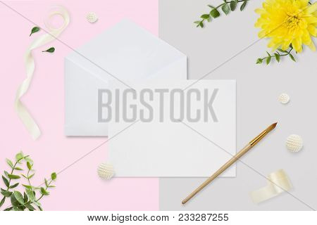 Letter, Envelope And A Present On Pastel Pink Gray Background. Wedding Invitation Cards Or Love Lett