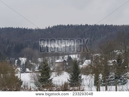 Winter View On Village Travnik With Chapel, Cottage And Trees, Snow Covered Rural Landscape With Spr