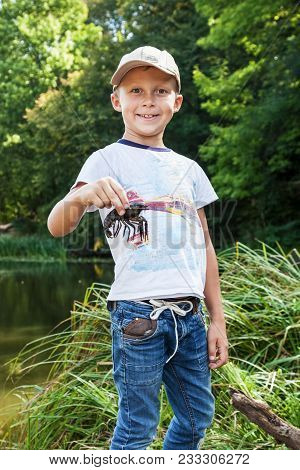 Boy Is Holding A Crawfish