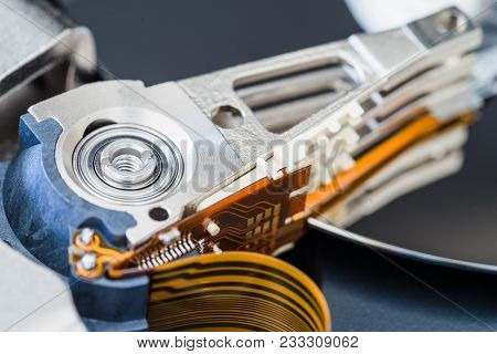 Hard Disk Drive Inside Close-up, Actuator Arm, Read Write Head, Ribbon Cable.