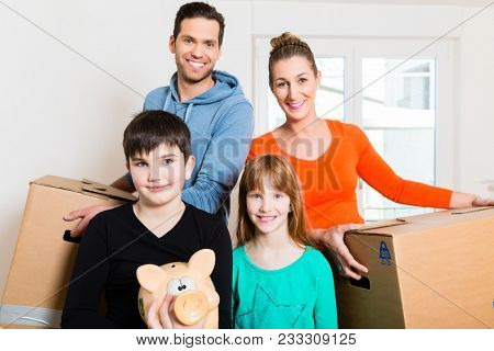 Family moving into new home carrying packing cases