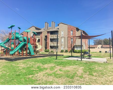 Apartment Complex Building With A Central Playground