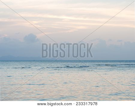 Clear Calm Sea Landscape With Nice Cloud And Sky At Sunset Twilight. Peace Sea In Pastel Color.