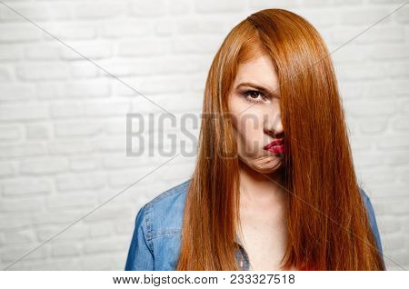 Portrait Of Upset Woman Unhappy With Her Red Hair. Frustrated Redhead Girl Needs A Haircut.