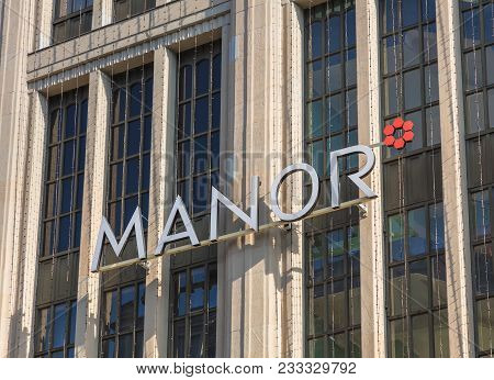 Zurich, Switzerland - 10 April, 2016: Part Of The Facade Of The Manor Department Store On Bahnhofstr