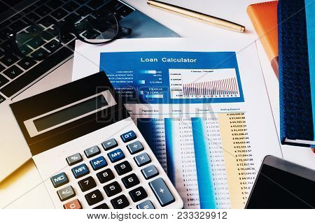 Loan Concept, Loan Calculator Paper With Calculator, Computer Labtop, Notebook And Smart Phone On Th