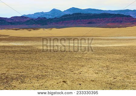 Dried Up Mud On An Eroded Rural Plain Creating A Badlands Landscape Taken Near Tecopa, Ca