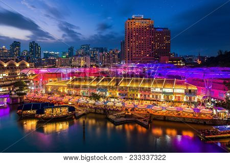 Night Marker And Bar With Waterfront And River In Singapore City, Singapore