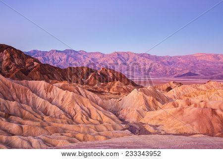 Scenic view from Zabriskie Point, showing convolutions,  color contrasts, and texture in the eroded rock at dawn, Amargosa Range,  Death Valley National Park in California, United State