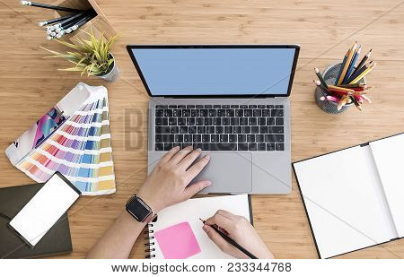 Top View Of Designer Using Laptop On Desk At Office With Blank Screen Smartphone,graphic Designer Ta
