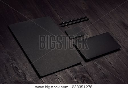 Corporate Identity Set Of Blank Black Letterhead, Envelope, Business Card On Dark Wood Board, Inclin