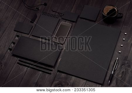 Modern Stylish Working Place With Blank Black Stationery, Phone, Cofee On Dark Wood Board, Inclined.