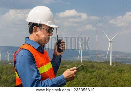 Male Architect Or Engineer, Use Hand-held Transceiver Radio And Digital Wireless Tablet Device, Work