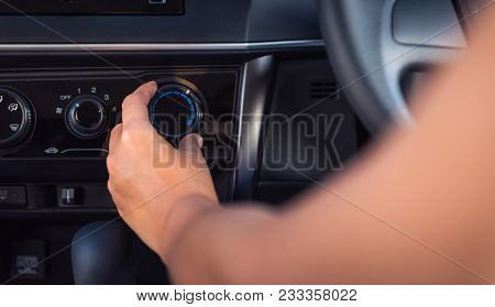 Close-up Portrat Of Woman Hand Turning On Car Air Conditioning System., Increase,decrease Air Flow