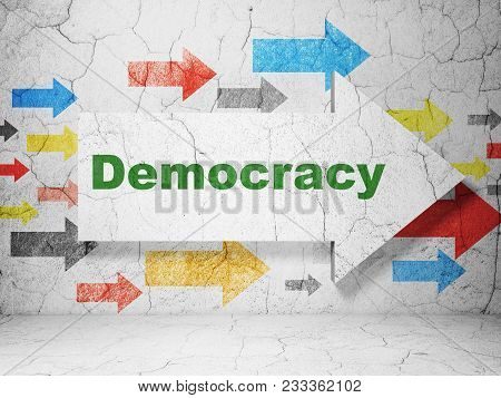 Political Concept:  Arrow With Democracy On Grunge Textured Concrete Wall Background, 3d Rendering