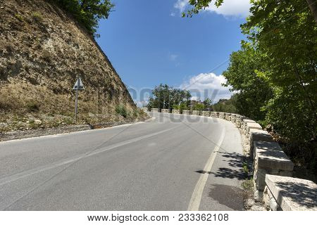 Paved Road In The Mountains Among The Greenery, Blue Sky, Road In Greece, Trees Growing On The Sidel