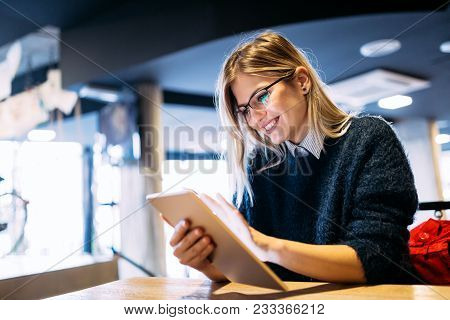 Portrait Of Young Attractive Woman Using Digital Tablet