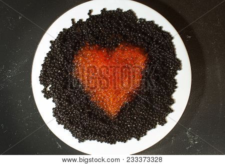 Drawing A Heart Out Of Red Caviar On The Background Of Black Caviar