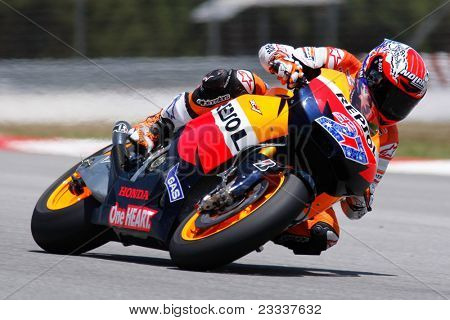 SEPANG, MALAYSIA - FEBRUARY 22: MotoGP rider Casey Stoner of Repsol Honda Team practices at the 2011 MotoGP winter tests at the Sepang International Circuit. February 22, 2011 in Malaysia.
