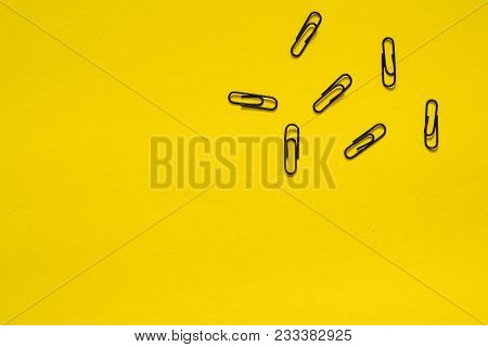 Paper Clips On Yellow Background. Text Place
