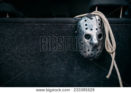 Hockey mask, rope, murderer concept
