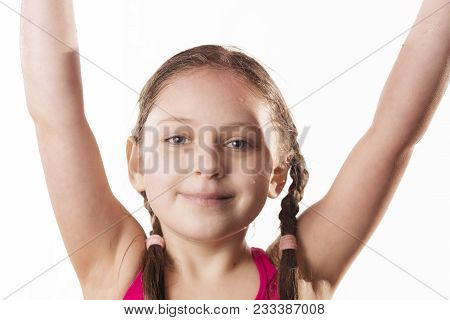 Little Smiling Caucasian Girl, Close-up Photo On White Background. Sport And Recreation Concept.