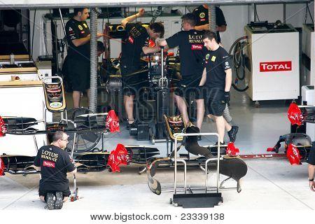 SEPANG, MALAYSIA - APRIL 8: Lotus Renault GP Team mechanics work on Vitaly Petrov's car on the first practice day of the Petronas Malaysian F1 Grand Prix on April 8, 2011 Sepang, Malaysia.