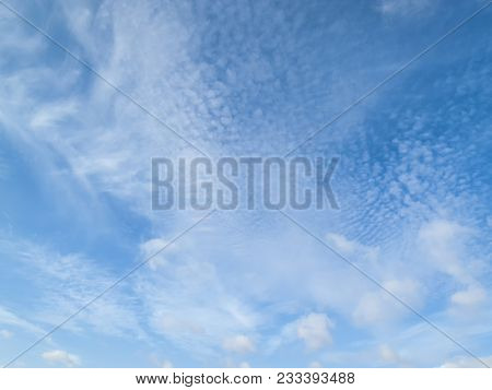 Cloudscape background of cirrus and cumulus clouds poster