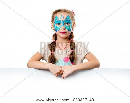 Girl with painted face holding white papper