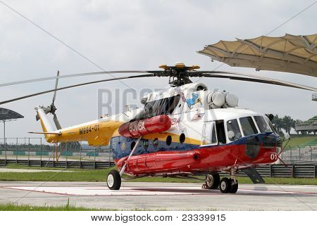 SEPANG - JUNE 17: A rescue helicopter from the Fire Department parks on standby in the Sepang International Circuit during the GT Asia Series race on June 17, 2011 in Sepang, Malaysia.