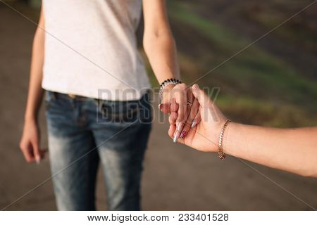Guy With A Girl Holding Hands