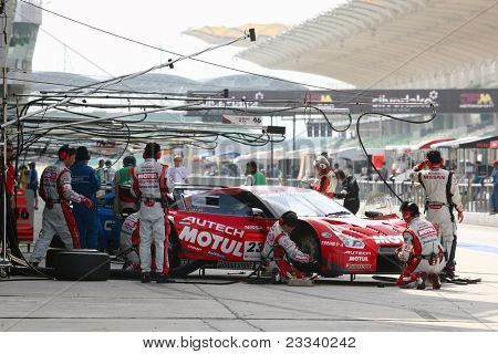 SEPANG, MALAYSIA - JUNE 19: NISMO's mechanics work on the team's Nissan GT-R R35 car during a practice session of the Japan SUPER GT Round 3 race on June 19, 2011 in Sepang International Circuit, Sepang, Malaysia.