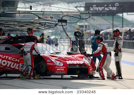SEPANG, MALAYSIA - JUNE 19: NISMO's mechanics work on the team's Nissan GT-R R35 car during a practice session of the Japan SUPER GT Round 3 race on June 19, 2011 in Sepang International Circuit, Malaysia.