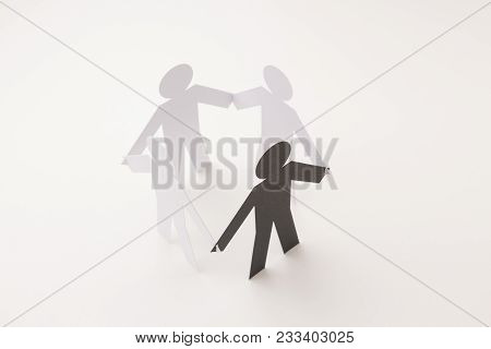 Closed Joining Of Four Paper Figure With Black One In Hand Down Posture On Bright White Background.
