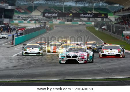 SEPANG - JUNE 19: Race cars take off from a rolling start in the GT300 race of the Japan SUPER GT Round 3 at the Sepang International Circuit on June 19, 2011 in Sepang, Malaysia.