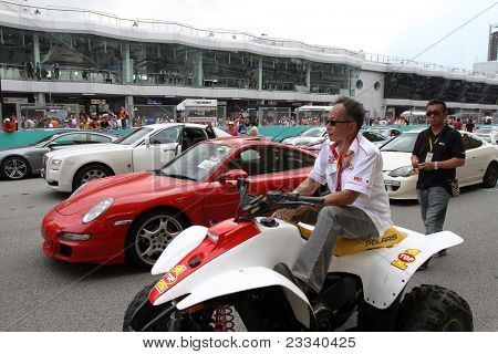 SEPANG, MALAYSIA - JUNE 19: Luxury cars and sports cars line up the race track on display during the Supercars Parade event in the Sepang International Circuit on June 19, 2011 in Sepang, Malaysia.