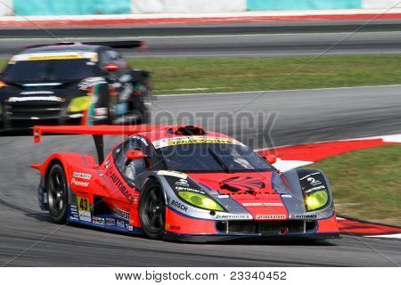 SEPANG - JUNE 19: The Garaiya VQ35DE car of the Autobacs Racing Team Aguri laps up the Sepang International Circuit tracks in the Japan SUPER GT Round 3 race on June 19, 2011 in Sepang, Malaysia.