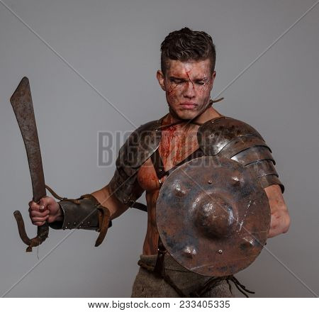 Gladiator Prepares To Attack His Enemy Holding Sword And Shield