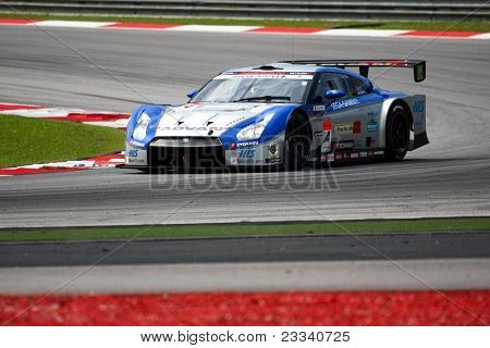 SEPANG, MALAYSIA - JUNE 18: The Nissan GTR car of Kondo Racing team puts in some practice laps in the Sepang International Circuit at the Japan SUPER GT Round 3 on June 18, 2011 in Sepang, Malaysia.
