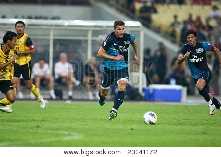 BUKIT JALIL - JULY 13: Arsenal's Robin van Piersie sees action in the second half against Malaysia on July 13, 2011 in Stadium Bukit Jalil, Malaysia. English league team Arsenal is on an Asia Tour.