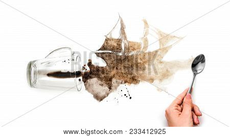 The Hand Draws A Ship. Spilled Coffee In The Shape Of A Ship. Brown Ship On White Paper. Close Up. I
