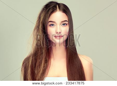 Hair Care . Keratin Straightening ,smoothing And Treatment Of The Hair .  Girl With Straight And Smo