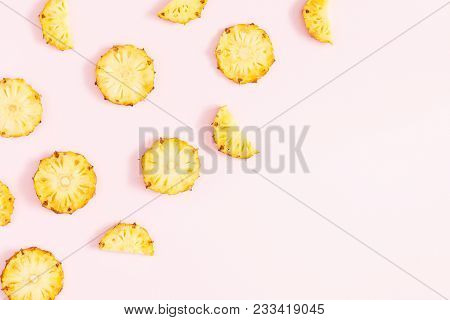 Pineapples On Pink Background. Pattern Made Of Sliced Pineapples. Flat Lay, Top View, Copy Space
